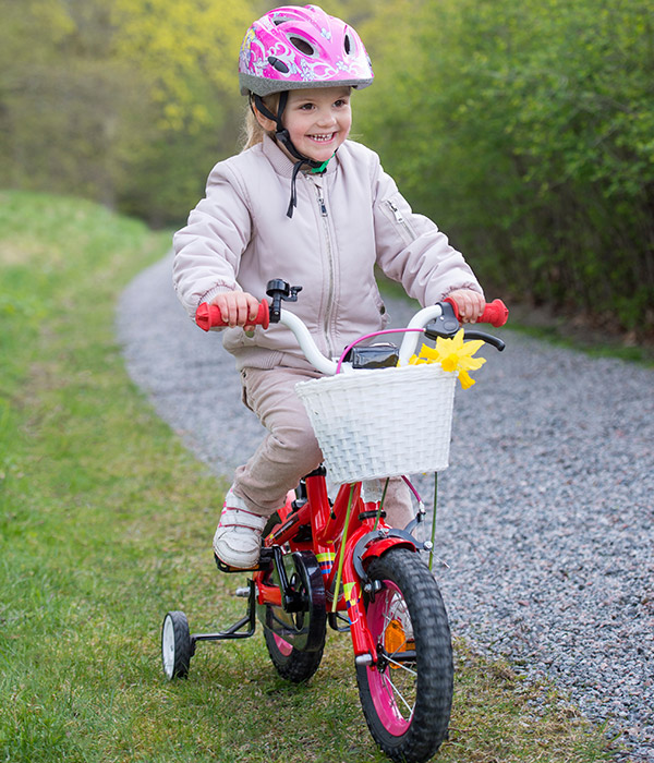 Princess Estelle of Sweden cycles around the gardens at ...