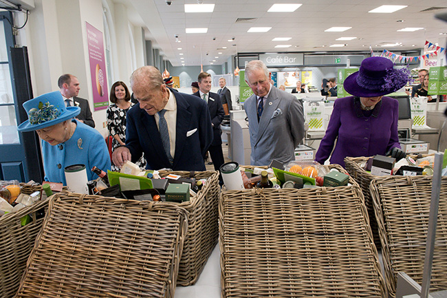 The Queen presented with a hamper during visit to Waitrose in Poundbury