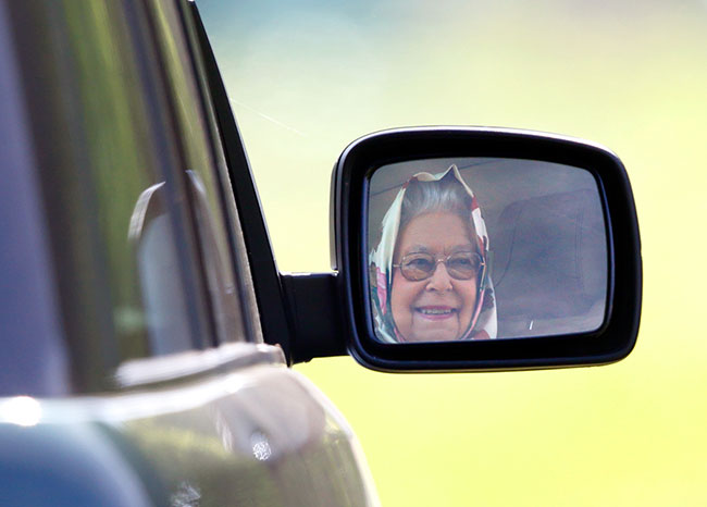 queen-smiling-driving-car-mirror