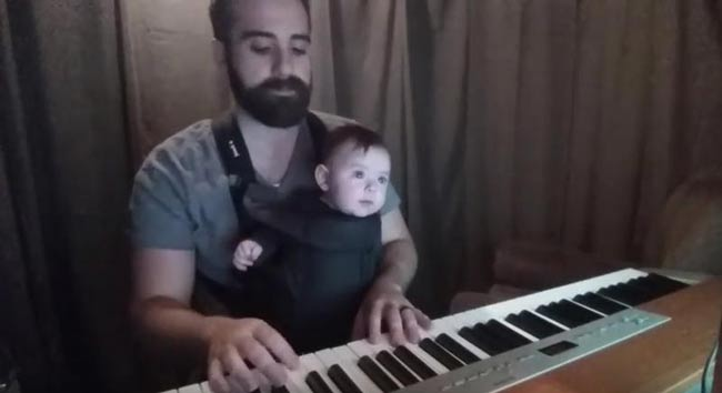 Watch father soothe baby to sleep with sweet piano lullaby