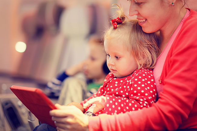 family-travel-mother-daughter-airplane