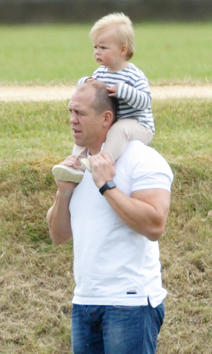 Doting dad Mike Tindall, a former pro rugby player, lifted his daughter onto his shoulders as the two watched Prince William and Prince Harry play in a charity polo match.