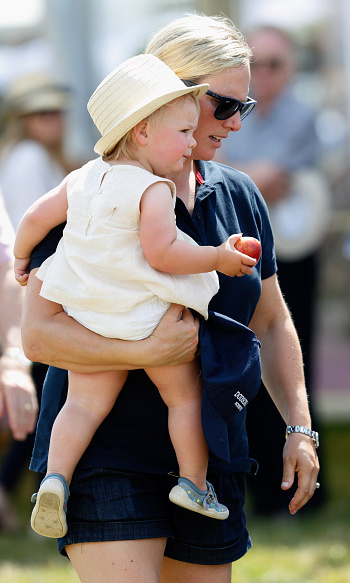 Mother and daughter enjoyed a day out at a riding festival at Gatcombe Park in England. Keeping cool, the youngster wore a sleeveless yellow top and a  straw fedora.