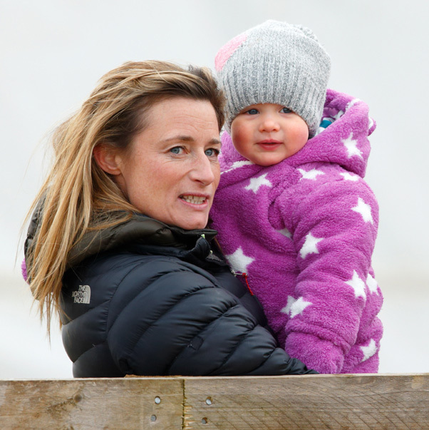 All wrapped up! The one-year-old looked adorable in a purple snowsuit as she cuddled up to her mom's friend Dolly Maude at Cocklebarrow Racecourse.