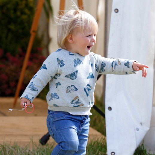 Enjoying a family day out at Whatley Manor International Horse Trials, Mia was ready for some serious play time in a butterfly sweater and jeans.