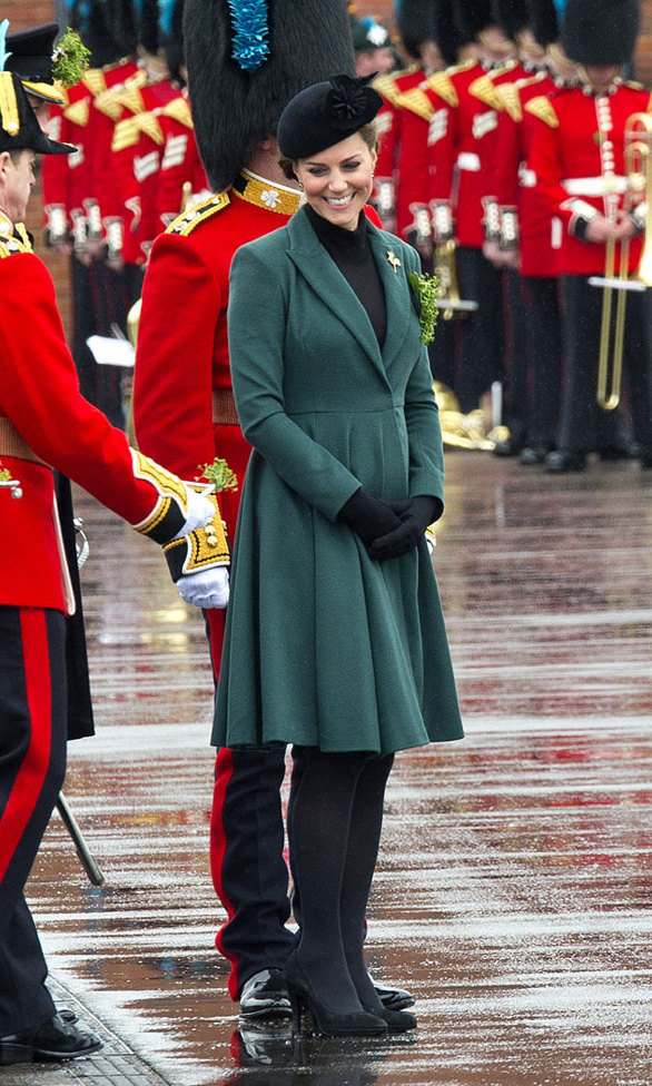 <p>We're loving this coat that Kate wore to the parade in 2013. While she styled it with a black turtleneck and black tights, we've also seen her wear the piece over more colourful fare.