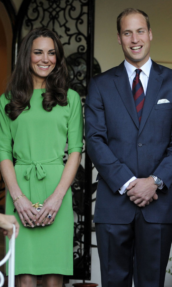 <p>This photo was taken back in 2011, soon after the royal wedding. Kate looked very professional in the belted lime-hued dress with three-quarter sleeves.