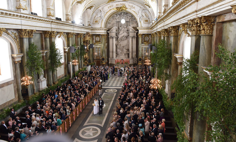 "Hundreds gathered in the Royal Chapel in Stockholm to watch the couple say ""I do.""