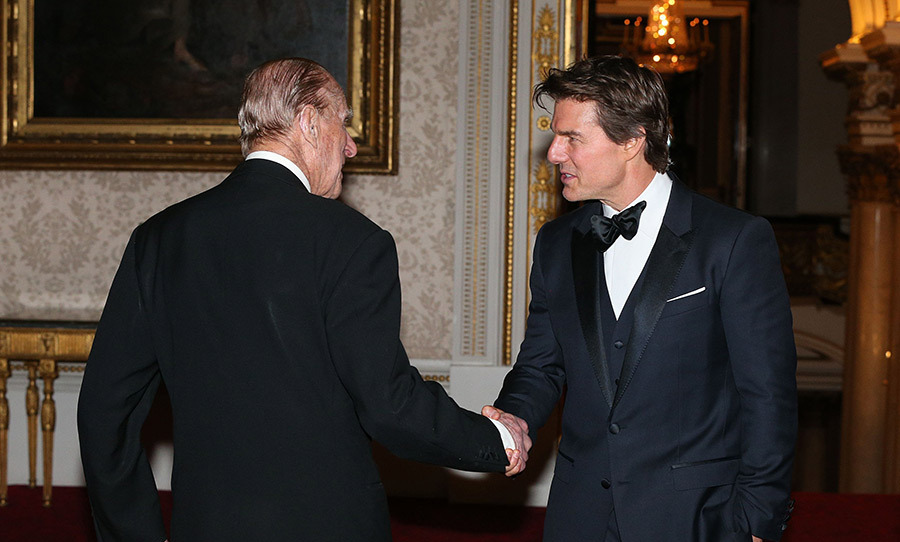 Tom cruise shares a laugh with prince philip at charity for Cuisine tom cruise
