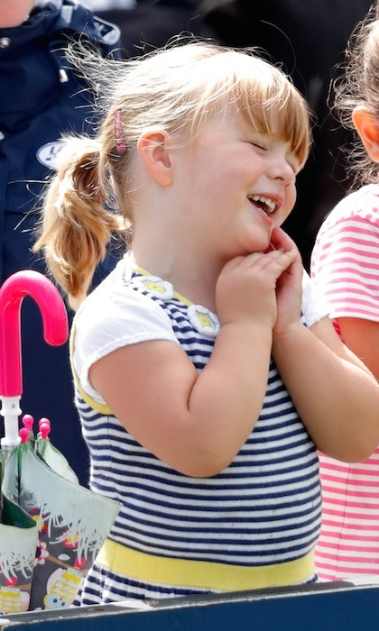 Three-year-old Mia stole the 2017 Festival of British Eventing at Gatcombe Park. The toddler watched on the sidelines as her mom Zara competed in the annual equestrian event. 