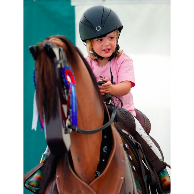 Mia hopped on a horse simulator to show her parents that she's ready to take the reins as the Royal Family's newest equestrienne. 