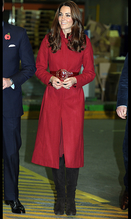 For a trip to Copenhagen, Kate dazzled in a red LK Bennett coat paired with a crocodile skin belt and knee-high suede boots. 