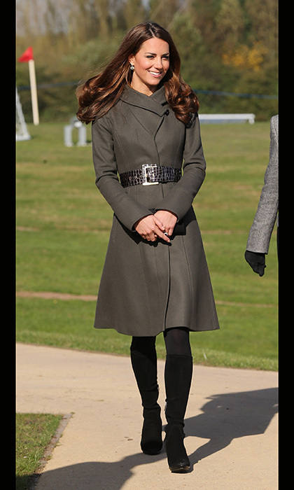 At the official opening of a soccer center, Kate fought off the autumn chill in a military-green coat by Reiss. 