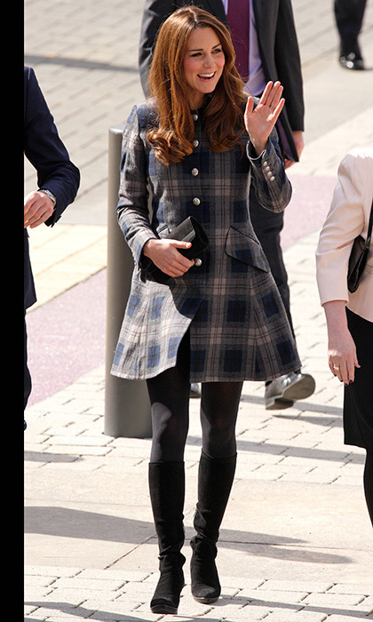 In Glasgow, she was warm yet stylish in a blue tartan Moloh coat and grey tights. 