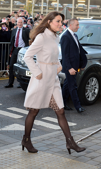 While visiting a children's hospital, Kate accessorized her pink MaxMara coat with a pair of Aquatalia Rouge brown booties. 