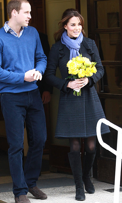 The pregnant royal greeted well-wishers while leaving the hospital after being treated for extreme morning sickness during her first pregnancy in a blue tartan coat by Diane Von Furstenberg and a matching lilac scarf. 