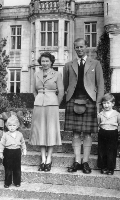 Anne pictured with her mother, father and older brother outside Balmoral Castle in 1952.