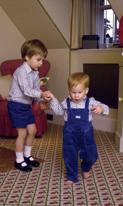 William gives his little brother a helping hand.