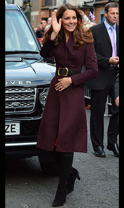 The beloved royal battled the chilly weather in a sophisticated, eggplant-colored coat.