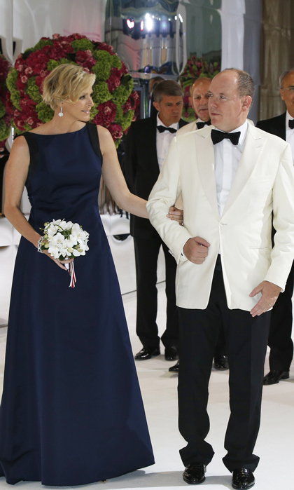 The 36-year-old princess wore a floor-length navy blue gown, dazzling diamond earrings and a jeweled headband for the 66th Monaco Red Rose Ball.