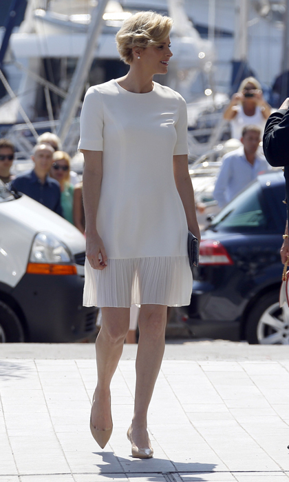 Wearing a floaty white dress with an on-trend sheer, pleated panel at the bottom, Princess Charlene was glowing as she met dignitaries at the opening of the Monaco Yacht Club.