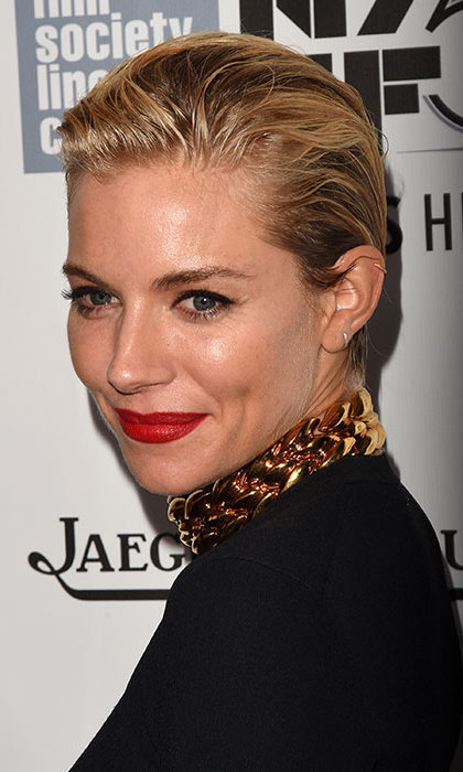 "If you want an updo but your hair isn't long enough, take a cue from <a href=""http://us.hellomagazine.com/tags/1/sienna-miller"" target=""_blank""><strong>Sienna Miller</strong></a>and slick it back and tie it into a low bun for an edgy red carpet look.