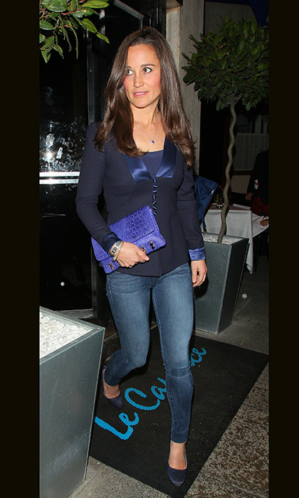 Pippa paired her skinny jeans with navy flats, a navy blouse and matching blue clutch for dinner.