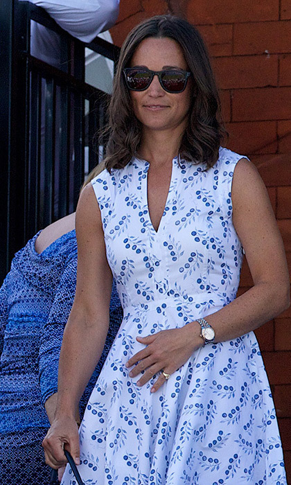 The British beauty kept it light and airy with this white-and-blue sundress.
