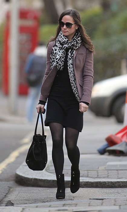 Pippa accessorized this black ensemble with an animal-print scarf and purple blazer.