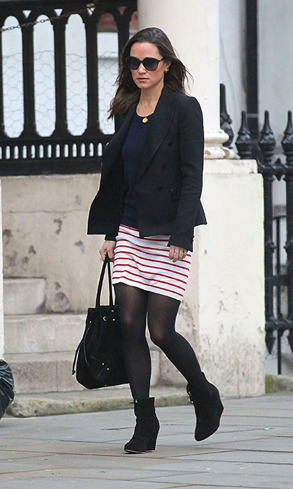 Pippa added some color to this dark look with a red-and-white striped skirt.