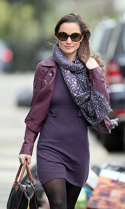 Pippa kept cozy in a purple knit dress with matching leather jack and purple printed scarf.