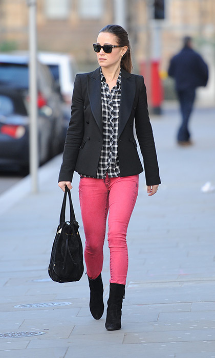 Not one to shy away from color on occasion, Pippa chose a pair of hot pink pants with a gingham blouse and navy jacket.