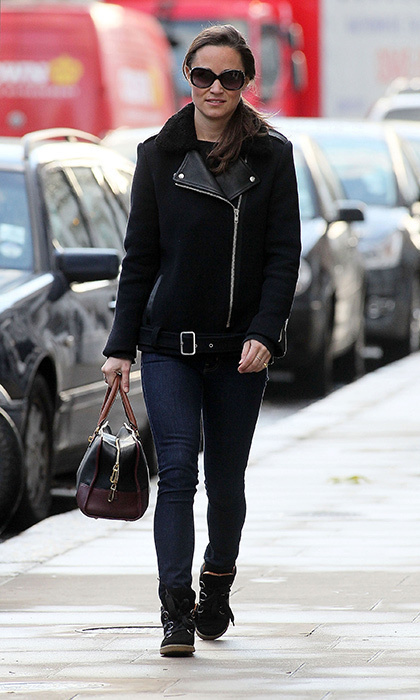 Pippa went moto-cool in dark wash skinny jeans and a black wool-and-leather jacket.