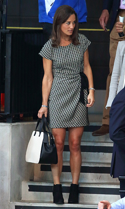 Pippa went monochromatic with a black-and-white patterned dress, black booties, and color-blocked handbag.