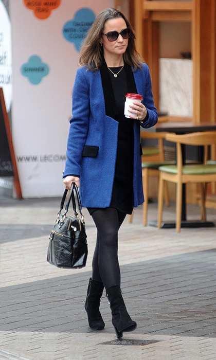 Out and about in London, Pippa paired a stylish blue coat with her signature black tights and boots. 