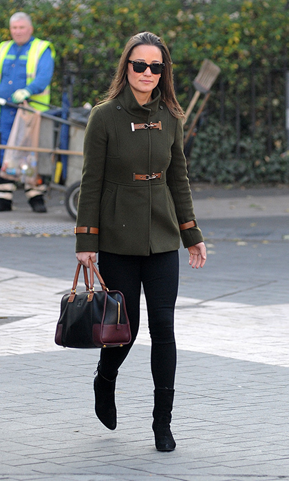Chic for fall, Pippa styled her black skinnies and black booties with an olive military-inspired coat with brown toggles.