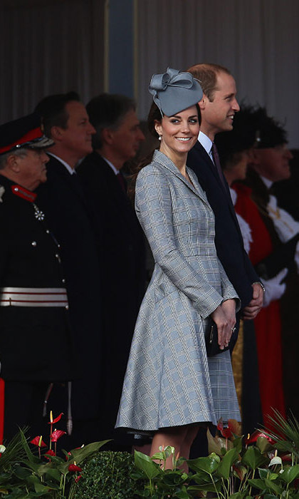 For her first appearance after announcing she was pregnant with royal baby number two, Kate stepped out in this stylish Alexander McQueen coat with a matching gray fascinator.