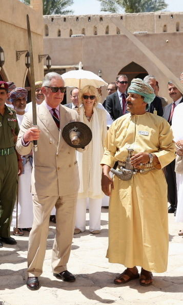 Prince Charles performed a traditional sword dance with local Omanis while visiting Nizwa Fort on their tour of the Middle East in 2013 in Nizwa, Oman.