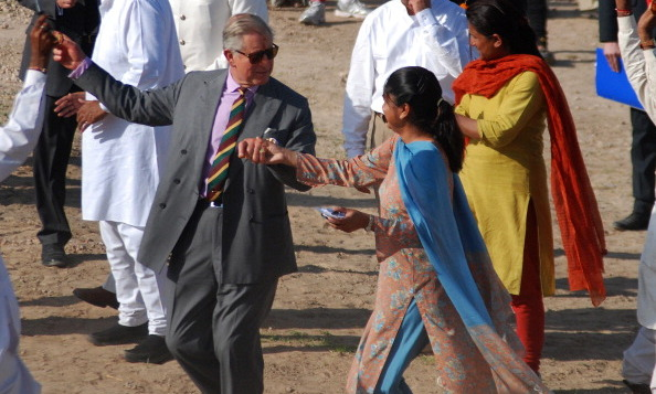 Prince Charles danced with the residents of Tolasar village, outside Jodhpur in 2010. 