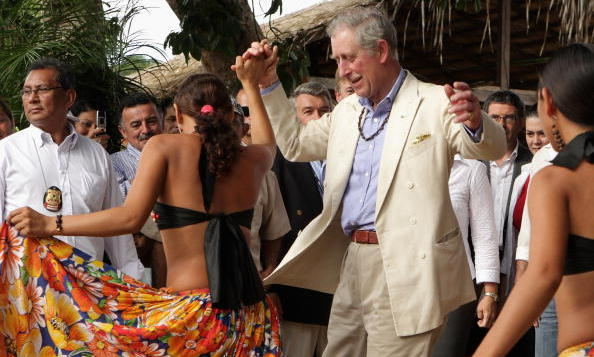 Prince Charles danced with a local during a visit to Maguari Village in the Amazon Rainforest at Santaram in 2009.