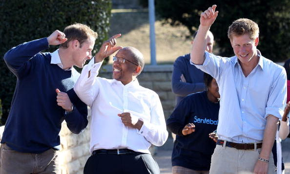 Princes Harry and William dance with Prince Seeiso as they visit the Mamahato Network Club for children affected by HIV at King Letsie's Palace in Lesotho in 2010.