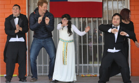 Prince Harry danced with children at the Fundacion Amigos de Jesus day care center during a visit to Santiago, Chile in June 2014.