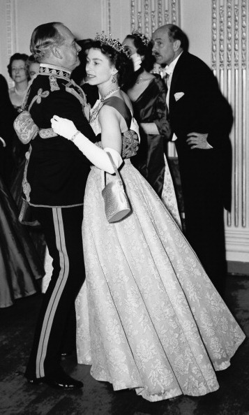 Queen Elizabeth looked lovely dancing at a ball in 1954.