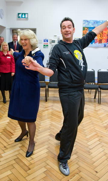 Camilla danced the Cha-Cha-Cha with Craig Revel Horwood - a judge on the British version of 'Dancing With The Stars' - during a visit to St Clement Danes School in 2009.