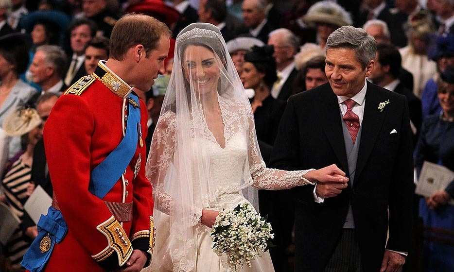 The blushing bride beamed at the two most important men in her life.