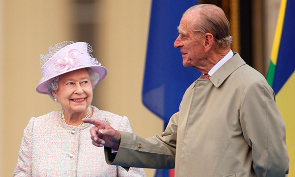 Queen Elizabeth II and Prince Philip attend the launch of the Queen's Baton Relay at Buckingham Palace on Oct. 9, 2013.