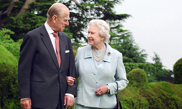 The Duke of Edinburgh escorts his wife for a walk at their honeymoon spot Broadlands in 2007 as they celebrated their 60th wedding anniversary.
