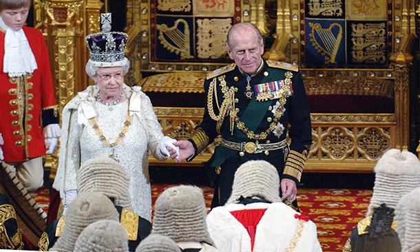 Queen Elizabeth ll and Prince Philip hold hands at the State Opening of Parliament on November 15, 2006 in London.