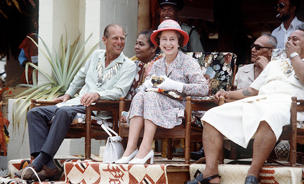 The royal couple are spotted laughing together on a visit to Tuvalu in the South Pacific in 1982.