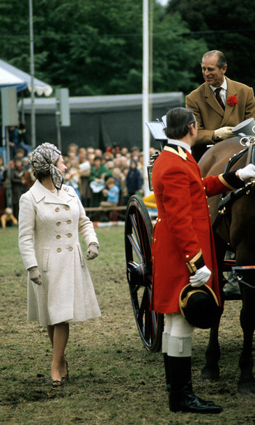 Queen Elizabeth ll encourages her husband as he takes part in a carriage driving competition at the Windsor Horse Show in May 1974.